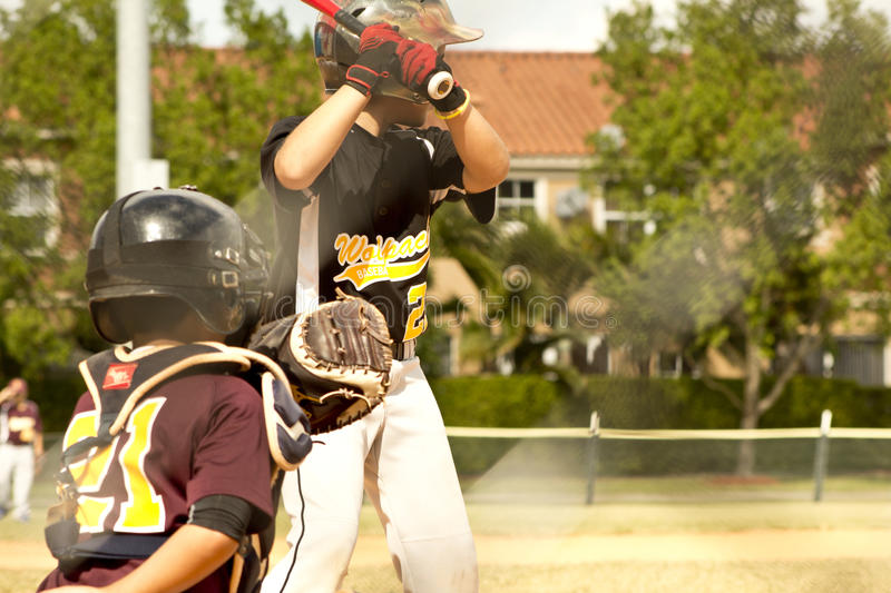Baseball Players. Kids playing Baseball in youth league royalty free stock images