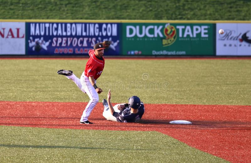 Baseball slide. Base runner tries to prevent the double play at the professional baseball game, Baseball Stadium, Lorain County, Ohio, United States stock photography