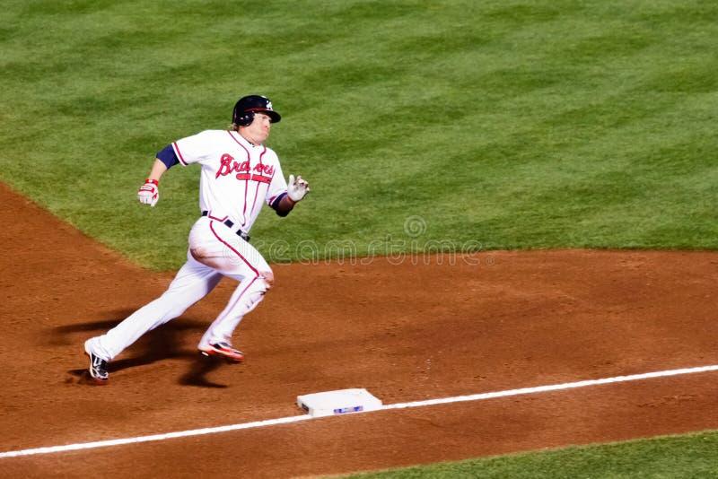 baseball som heading home att runda third royaltyfri fotografi