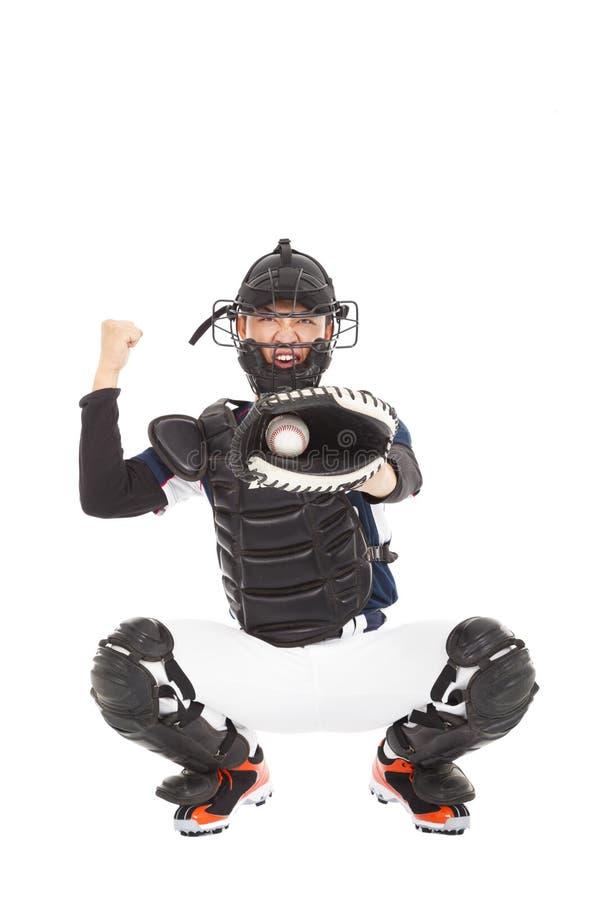 Baseball-Spieler, der Fänger, Signal zeigend, schlagen heraus lizenzfreie stockfotos