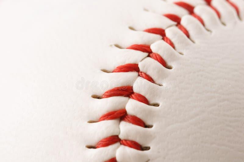 Baseball Stitches Macro. Close-up of the stitches on a baseball (narrow focus) stock photo