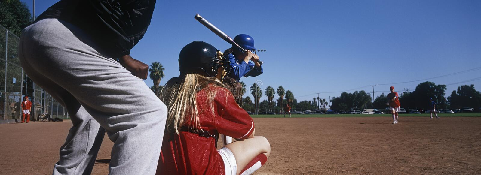 Baseball Team Practicing On Ground With Umpire. Professional female baseball team practicing on ground with umpire royalty free stock images