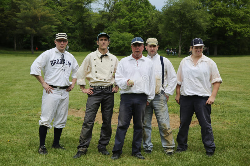 Baseball team in 19th century vintage uniform during old style base ball play following the rules and customs from 1864 royalty free stock image