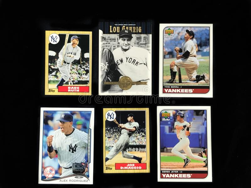 Baseball Trading cards on a black back drop. Cards of New York Yankees legends like Babe Ruth, Lou Gehrig, Yogi Berra, Joe DiMaggio, Derek Jeter and Alex royalty free stock images