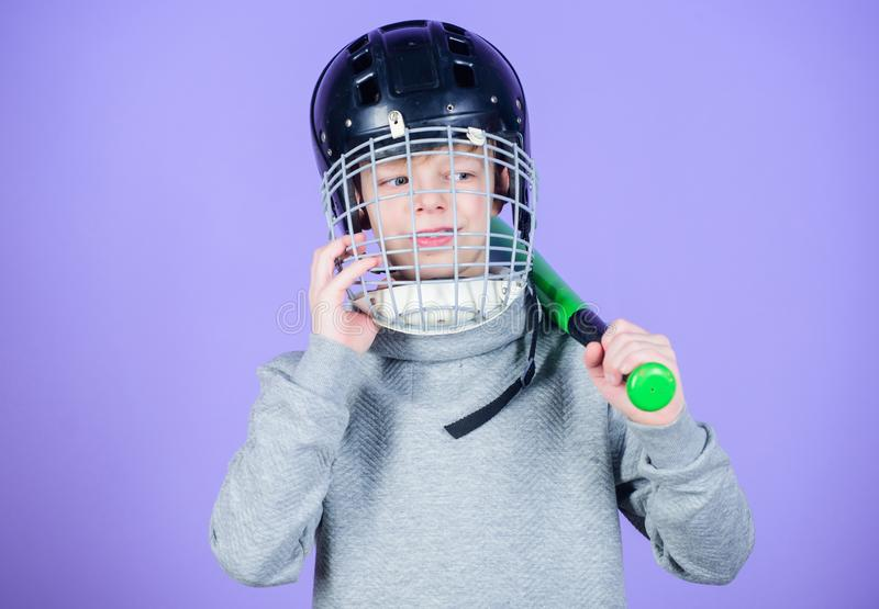 Baseball training concept. Boy in helmet hold baseball bat. Sport and hobby. Care about safety. Teenager boy likes stock photography