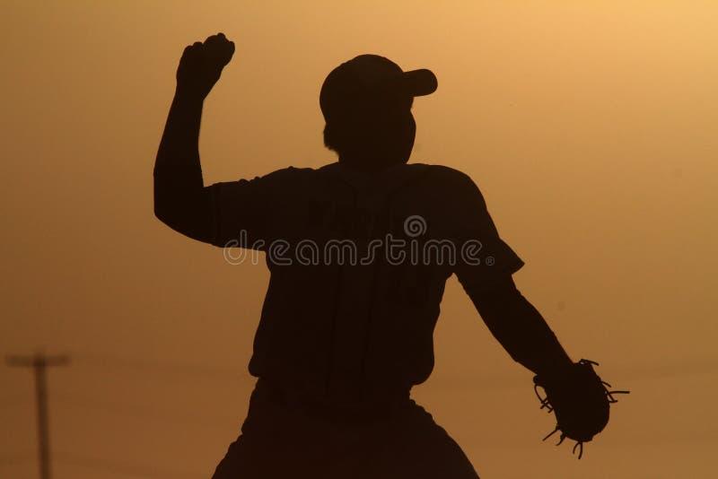Baseballa miotacz przy zmierzchem obrazy royalty free