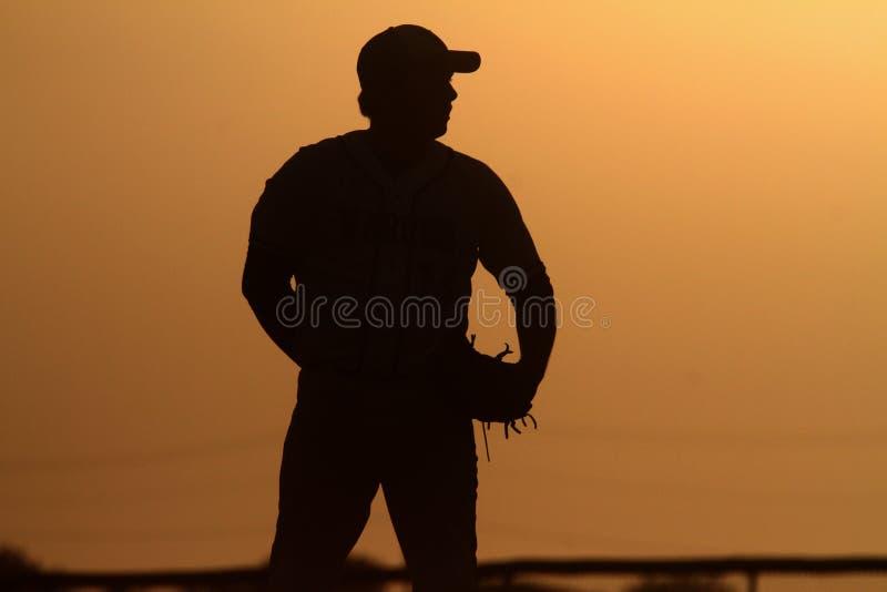 Baseballa miotacz przy zmierzchem zdjęcie stock