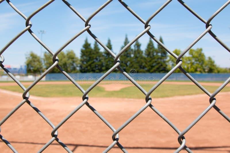 Baseballfält till och med staketet royaltyfria foton