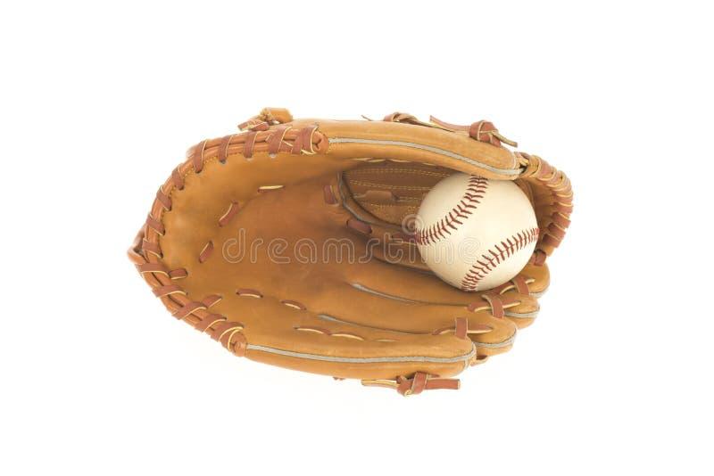 Baseballhandske med bollen som isoleras på vit arkivbild