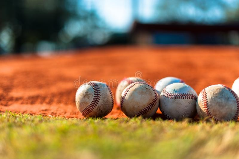 Baseballs on Pitchers Mound. Several Worn Baseballs on Pitchers Mound royalty free stock image