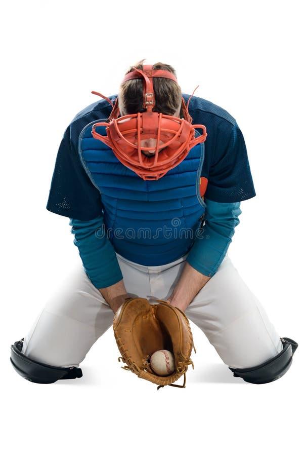 Basebollspelaren fångade en boll arkivbild