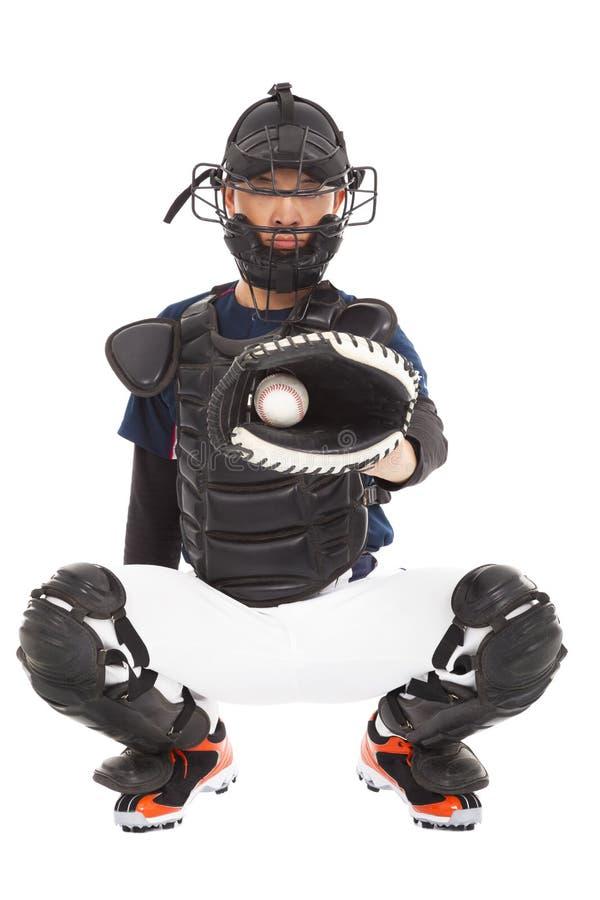 Basebollspelaren stoppare, catched en baseball royaltyfria foton