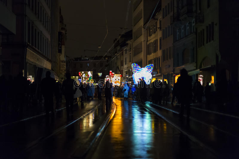 Basel carnival 2017. View on several main lanterns with light reflections on the wet street after rain on monday morning. Picture taken on 6 of March 2017 stock image