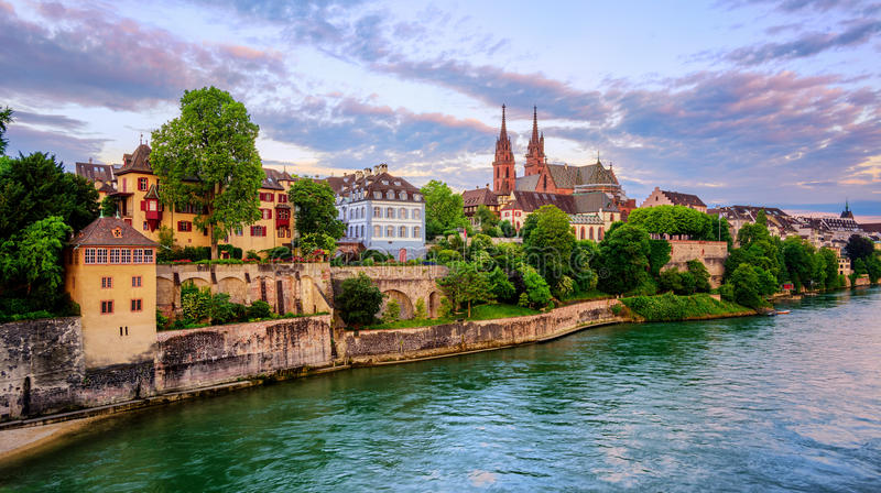Basel Old Town with Munster cathedral and Rhine, Switzerland. Panoramic view of the Old Town of Basel with red stone Munster cathedral and the Rhine river royalty free stock images