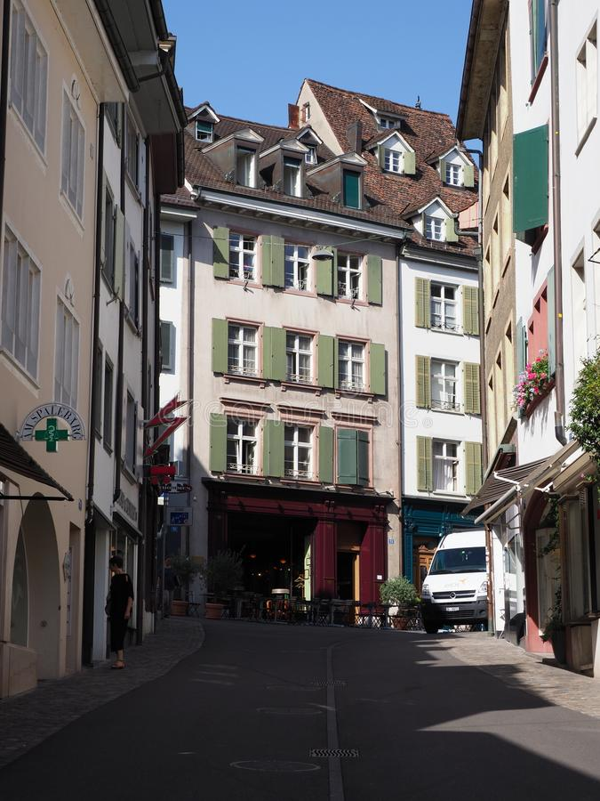 Colorful representative historical houses and street at european Basel city center in Switzerland - vertical royalty free stock photo
