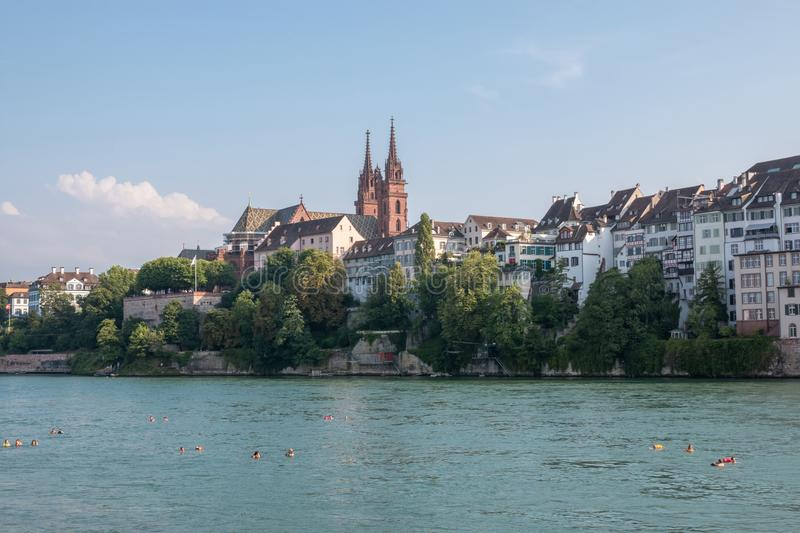 View on Basel city and river Rhine, Switzerland. People swim in water. Basel, Switzerland - June 23, 2017: View on Basel city and river Rhine, Switzerland royalty free stock images