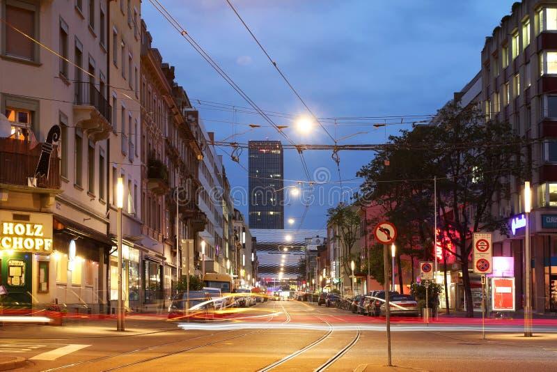 Basel, Switzerland. Street scene in downtown Basel, Switzerland with Basler Messeturm (Basel Trade Fair Tower royalty free stock images