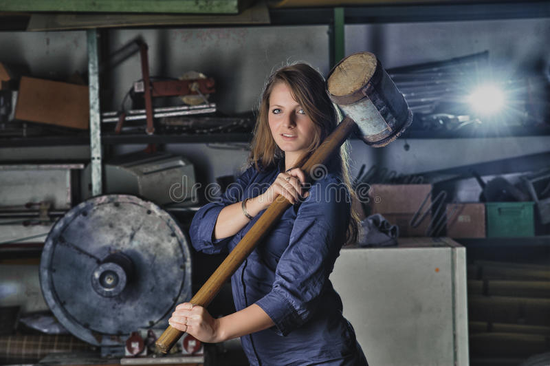 Basement. Portrait of girl posing in industrial basement stock images