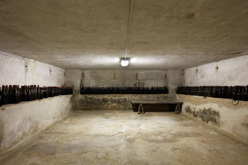 Basement with many wine bottles in old house interior. In Italy stock image