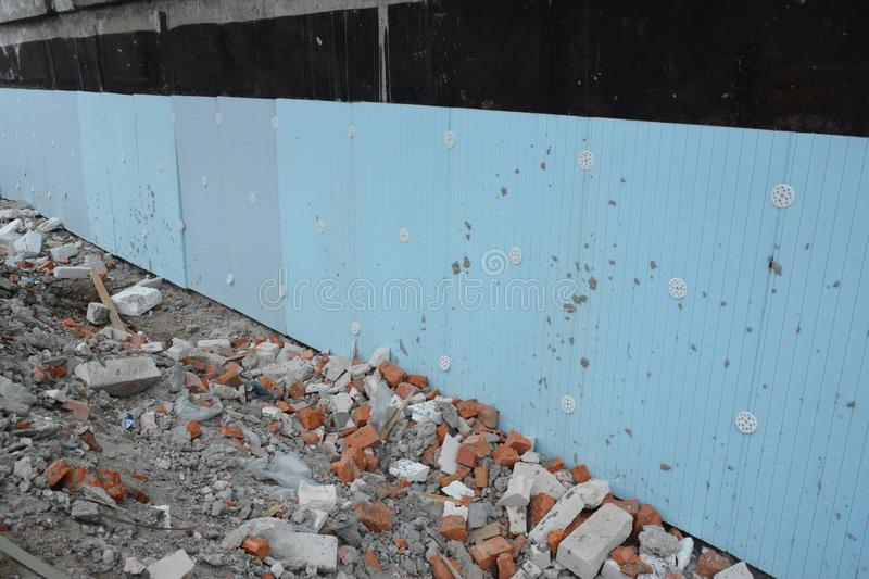 Basement rigid insulation details with damp proofing. House foundation insulation for energy saving stock images