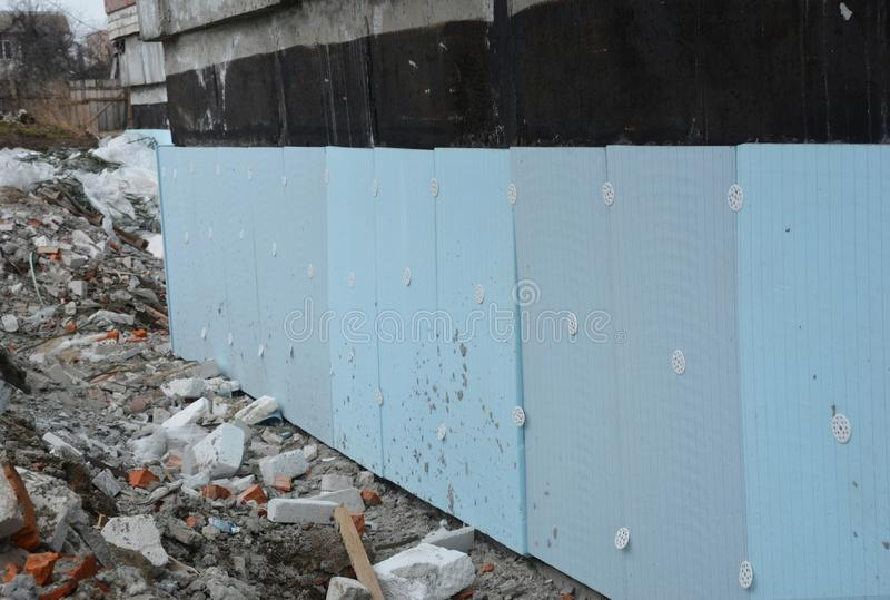 Basement rigid insulation details with waterproofing, damp proofing. House foundation insulation for energy saving stock images