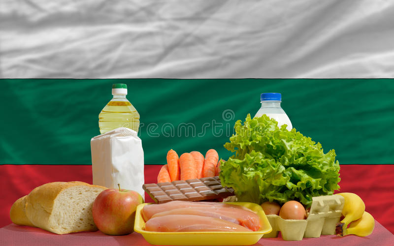 Basic food groceries in front of bulgaria flag. Complete national flag of bulgaria covers whole frame, waved, crunched and very natural looking. In front plan stock images