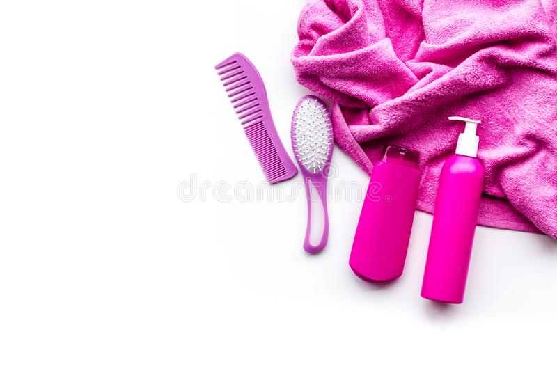 Basic hair care in bathroom. Comb, shampoo, spray, towel on white background top view copyspace. Basic hair care in bathroom. Comb, shampoo, spray, towel on royalty free stock photos