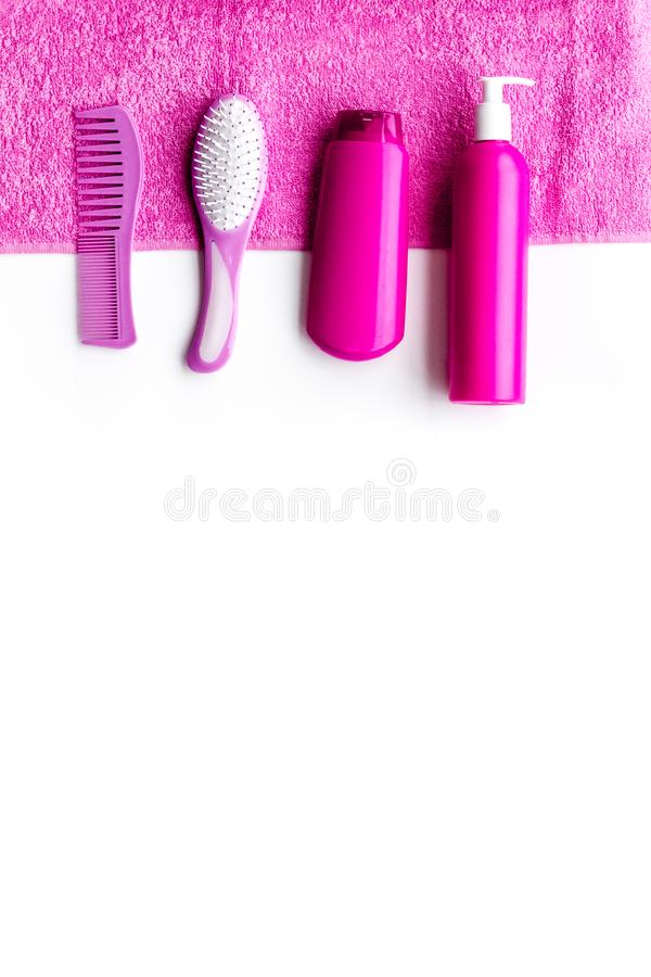 Basic hair care in bathroom. Comb, shampoo, spray, towel on white background top view copyspace. Basic hair care in bathroom. Comb, shampoo, spray, towel on stock photos