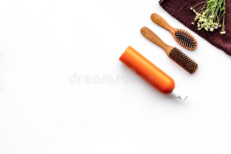 Basic hair care in bathroom. Comb, spray, towel on white background top view copyspace. Basic hair care in bathroom. Comb, spray, towel on white background top stock images