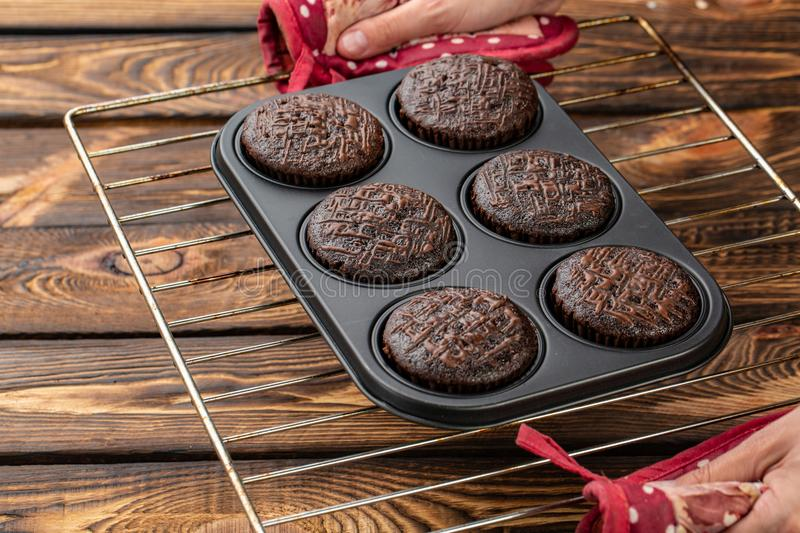 Basic homemade brownie or chocolate muffins raw dough in baking pan. Cooking homemade chocolate muffins, cupcakes royalty free stock photos