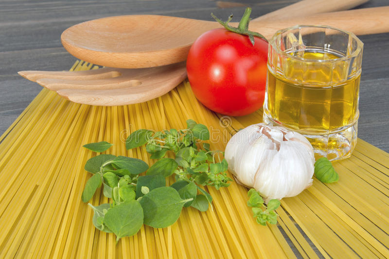 Basic ingredients for cooking spaghetti royalty free stock photo