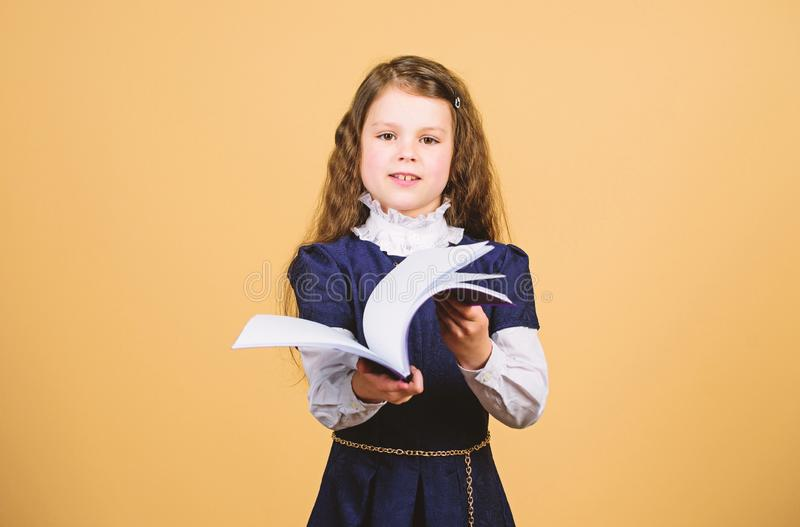 Basic knowledge. Back to school. Knowledge day. Serious about studying. Schoolgirl adorable child. Childhood and. Upbringing. Knowledge and information. Small royalty free stock photos