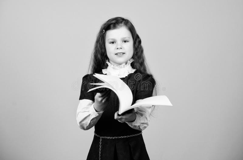 Basic knowledge. Back to school. Knowledge day. Serious about studying. Schoolgirl adorable child. Childhood and. Upbringing. Knowledge and information. Small royalty free stock image