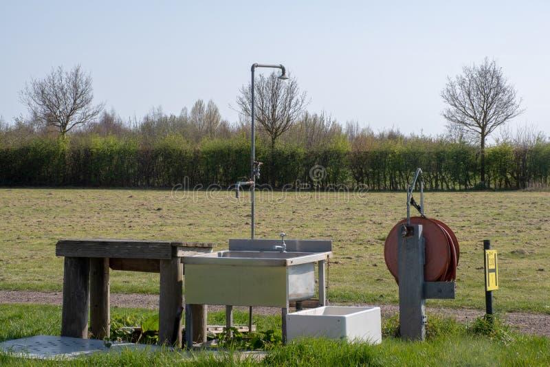 Basic outside Washing facilities on campsite. Basic outside Washing facilities on outdoor campsite stock photo