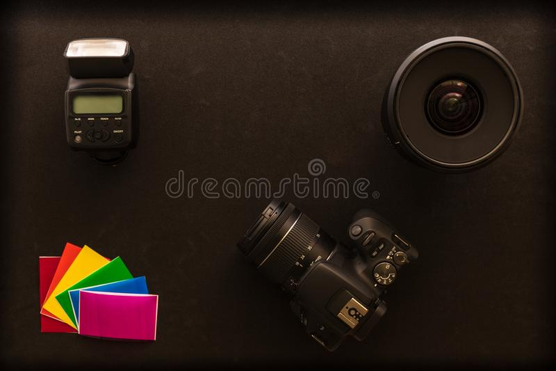 Basic photographic equipment, flash,lens, color gels stock images