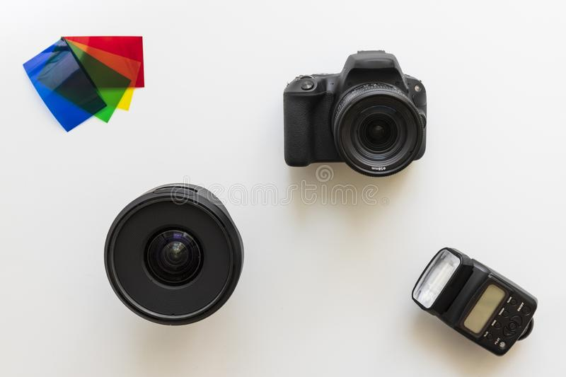 Basic photographic equipment, flash,lens, color gels royalty free stock photography