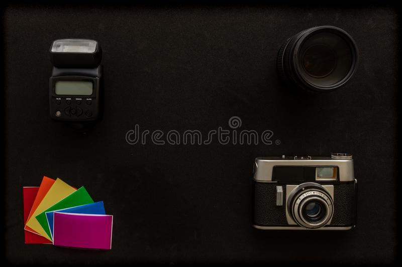 Basic photographic equipment, flash,lens, color gels royalty free stock images