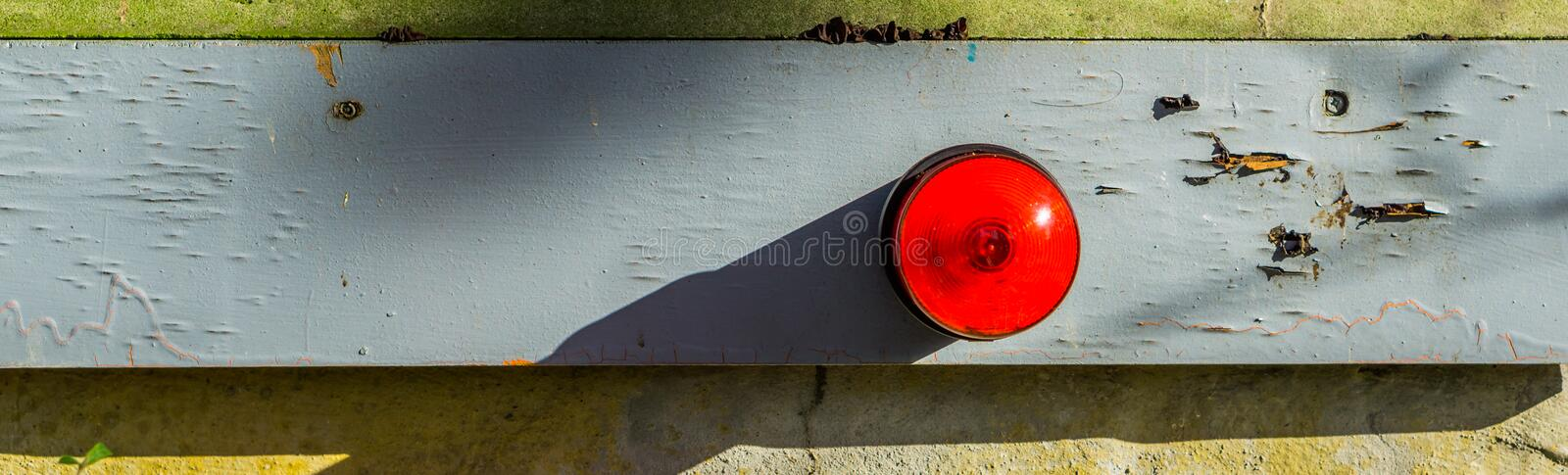 Basic red alarm light, security system for safety. A basic red alarm light, security system for safety, unlit alarm royalty free stock photography