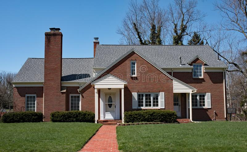 Basic Red Brick Home with Long Brick Walk stock photos