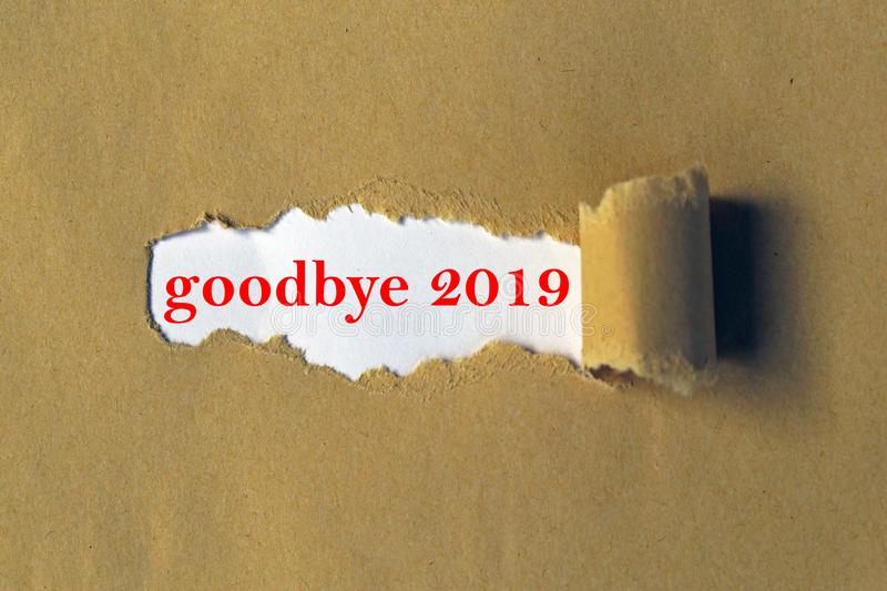 Goodbye 2019. Heading behind torn paper stock photo