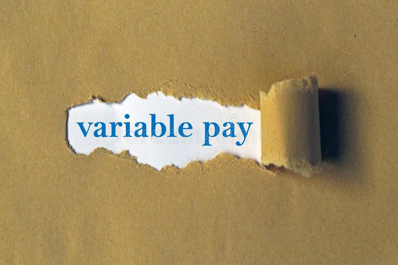 Variable pay. Words on white paper royalty free stock photos