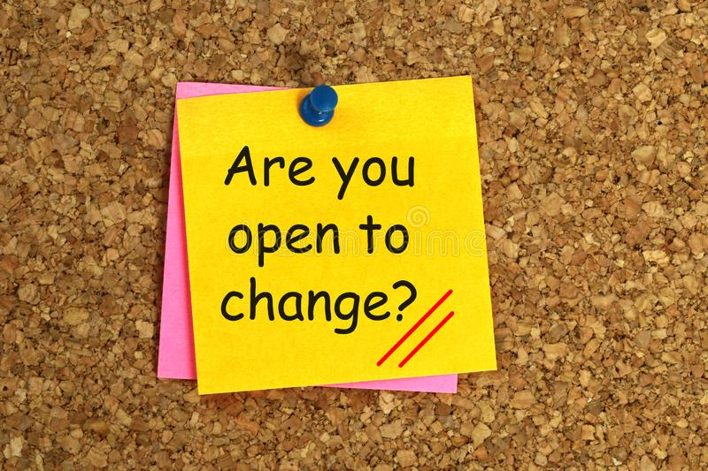 Are You Open To Change Message. An 'are you open to change message' written on a Post-it, stuck on a cork board with a pushpin royalty free stock photos