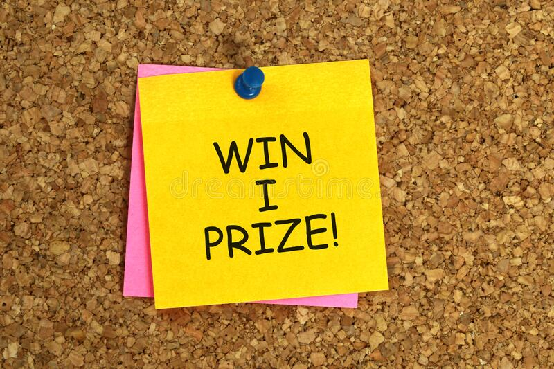 Win i prize post it. On corkboard royalty free stock photography