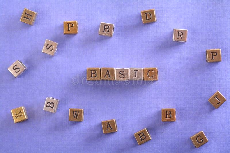 Basic word metal block stock image
