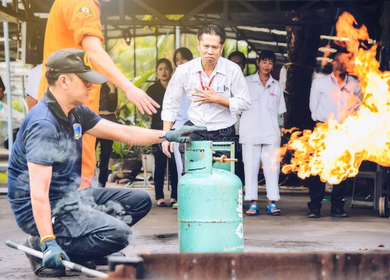 Basicfire fighting and evacuation fire drill Training on november 15 , 2017 in Bangkok, thailand. stock images