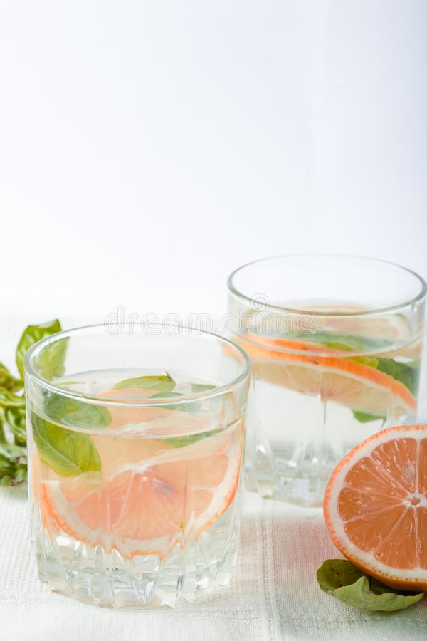 Basil grapefruit water. Drink infused water cocktail. Healthy lifestyle concept. stock image