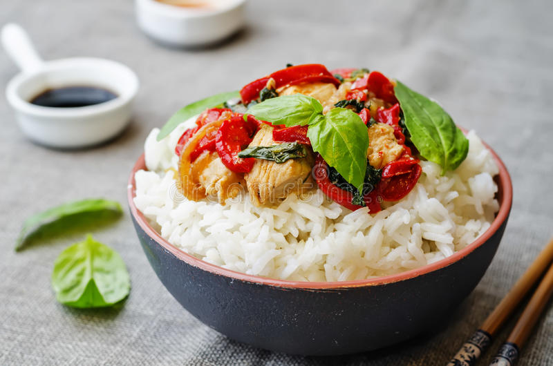 Basil pepper chicken stir fry with rice. The toning. selective focus royalty free stock photos