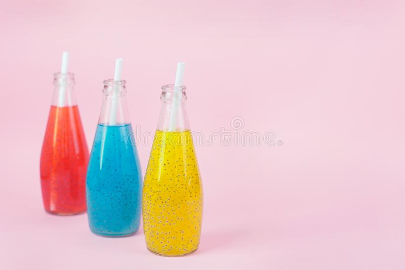 Basil Seed Drink in glass Bottles on pink background royalty free stock photography