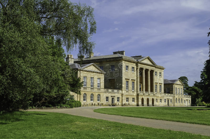 Basildon Park country house, Berkshire, England. Sunny view of Basildon Park Country House, Berkshire, England, showing drive stock image