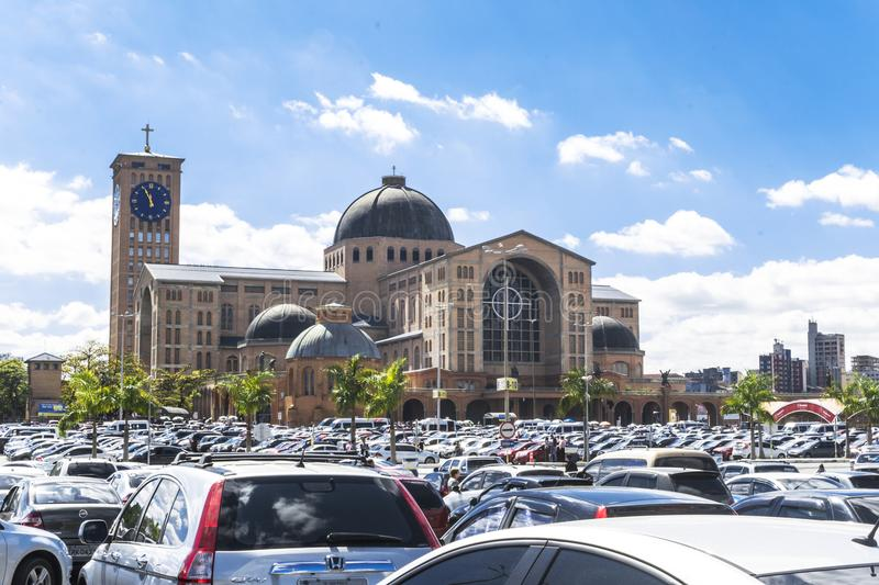 Aparecida cathedral in Sao Paulo, Brazil - External view. APARECIDA, SAO PAULO - BRAZIL - AUG 6, 2017: Parking of the Basilica of the National Shrine of royalty free stock images